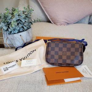 Brand new Louis Vuitton mini pochette ebene